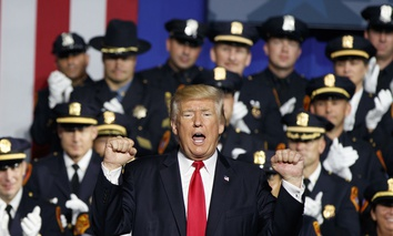 President Donald Trump pumps his fist after speaking to law enforcement officials on the street gang MS-13, Friday, July 28, 2017, in Brentwood, N.Y.