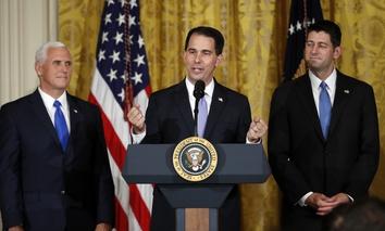 Wisconsin Gov. Scott Walker, accompanied by Vice President Mike Pence, and House Speaker Paul Ryan of Wis., speaks in the East Room of the White House, Wednesday, July 26, 2017