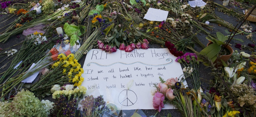 Notes and flowers form a memorial in Charlottesville, Va., on Friday, Aug. 18, 2017 at the site where Heather Heyer was killed. Heyer was struck by a car while protesting a white nationalist rally on Saturday Aug. 12.