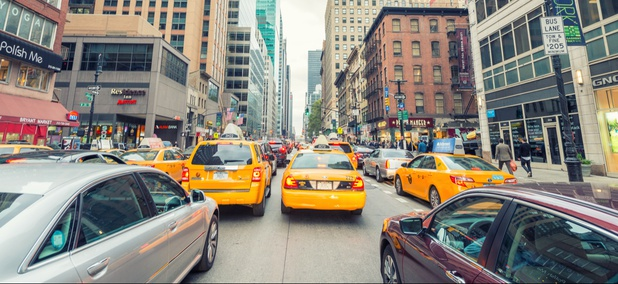 Traffic on Sixth Avenue near 38th Street in midtown Manhattan.