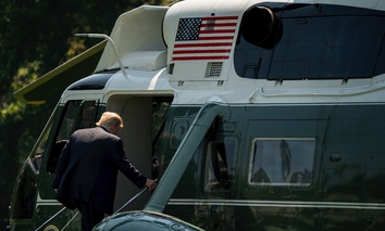 President Donald Trump boards Marine One on the South Lawn of the White House in Washington, D.C. on Tuesday before heading to Arizona.