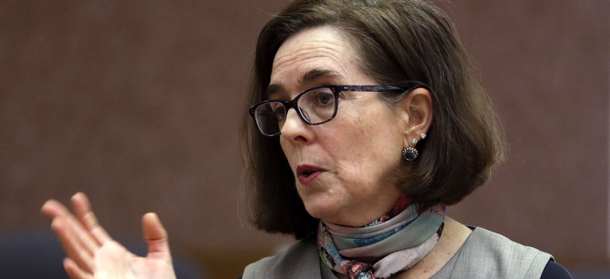 Oregon Gov. Kate Brown speaks to media representatives in Salem, Ore. on Jan. 26, 2017.