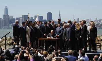 California Gov. Jerry Brown signs a climate bill on July 25 in San Francisco.