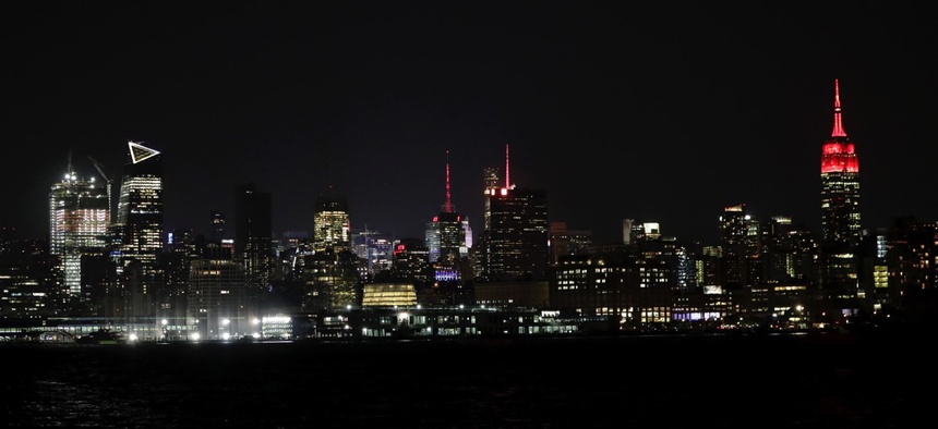 The Empire State Building, right, is lit up in red color in an effort to bring awareness of people living with HIV/AIDS in May 2017.