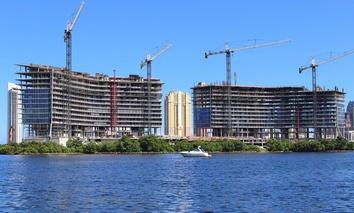 Cranes loom over construction sites in Miami.