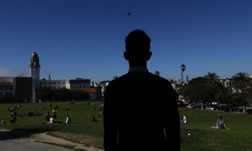 A 16-year-old from Eritrea looks out over Dolores Park in San Francisco. When he landed in March, he was among the last refugee foster children to make it into the U.S. before the Trump administration declared travel bans that halted the small, three-deca