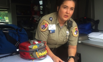 Cabell County EMT Tabitha Perez demonstrates how medics administer naloxone to overdosing patients, in Huntington, W.Va.