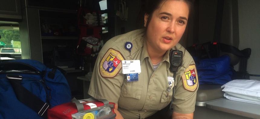 Cabell County EMT Tabitha Perez demonstrates how medics administer naloxone to overdosing patients, in Huntington, W.Va.