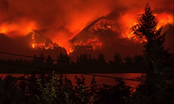 A fast-moving wildfire chewing through Oregon's Columbia River Gorge on Sept. 4.