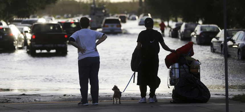 Evacuees leave the Germain Arena in Estero, Fla., which was used as an evacuation shelter for Hurricane Irma,