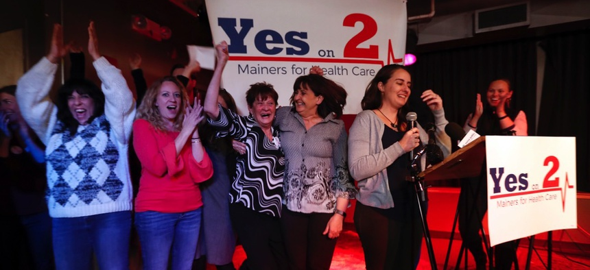 Supporters of Medicaid expansion celebrate their victory, Tuesday, Nov. 7, 2017, in Portland, Maine.
