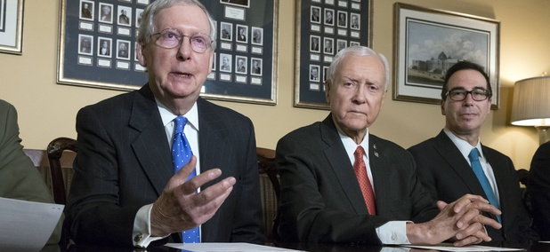 From left, Senate Majority Leader Mitch McConnell, R-Ky., Senate Finance Committee Chairman Orrin Hatch, R-Utah, and Treasury Secretary Steven Mnuchin, make statements to reporters as work gets underway on the Senate's version of the GOP tax reform bill.
