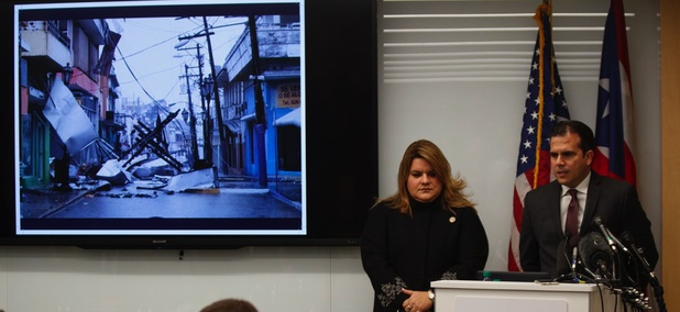 Puerto Rico Resident Commissioner Jenniffer González-Colón listens as Gov. Ricardo Rosselló speaks Monday during a Washington, D.C. news conference urging Congress to include the territory in the Supplemental Disaster Relief Package.