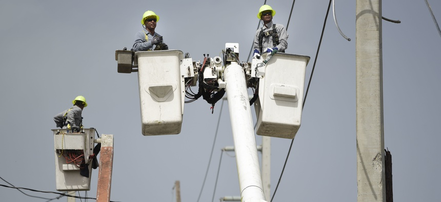 a brigade from the Electric Power Authority repairs distribution lines damaged by Hurricane Maria in the Cantera community of San Juan, Puerto Rico.