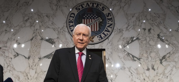 In this Nov. 13, 2017, photo, Senate Finance Committee Chairman Orrin Hatch, R-Utah, arrives as the tax-writing panel begins work on overhauling the nation's tax code.