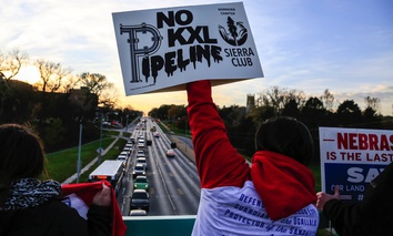 Opponents of the Keystone XL pipeline demonstrate on the Dodge Street pedestrian bridge during rush hour in Omaha, Nebraska on Nov. 1.