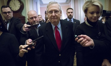 "Telling reporters ""we have the votes,"" Senate Majority Leader Mitch McConnell, R-Ky., walks to the chamber after a closed-door meeting with Republican lawmakers to advance the stalled GOP overhaul of the tax code, on Capitol Hill, Dec. 1, 2017."