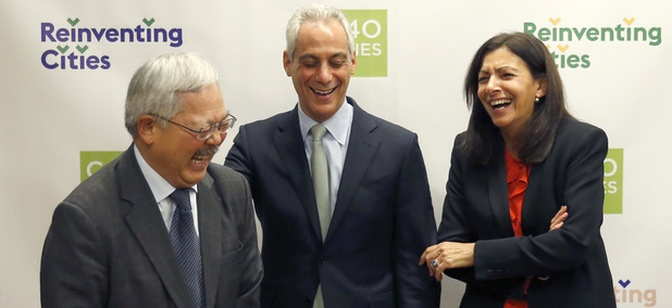 Chicago Mayor Rahm Emanuel, center, shares a laugh with fellow mayors Mayor Ed Lee, of San Francisco, left, and Mayor Anne Hidalgo, of Paris, at the North American Climate Summit in Chicago.