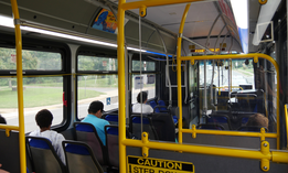 Commuters ride a bus in Falls Church, Virginia