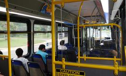 Commuters ride a bus in Falls Church, Virginia