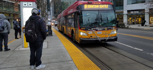 A Rapid Ride bus in Seattle uses a lane reserved for transit along Westlake Avenue.