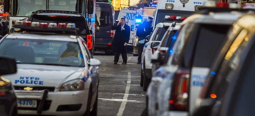 Police block a street by Port Authority Bus Terminal near New York's Times Square following an explosion on Monday, Dec. 11, 2017