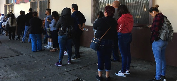 People wait in line at the Coalition for Humane Immigrant Rights Los Angeles for help with immigration paperwork.
