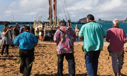 From left to right: Maui County Mayor Alan Arakawa, Hawaii County Managing Director Wil Okabe, Kauai County Mayor Bernard Carvalho Jr., and Honolulu Mayor Kirk Caldwell approach the Polynesian voyaging canoe Hōkūleʻa ahead of signing their proclamations.