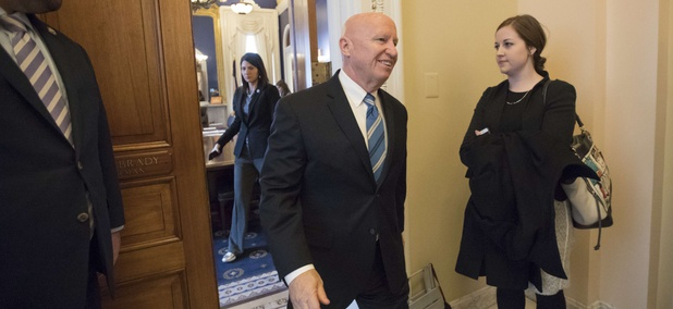 House Ways and Means Committee Chairman Kevin Brady, R-Texas, leaves his office in the Capitol as House Republicans prepare to advance the GOP tax bill, in Washington, Friday, Dec. 15, 2017.