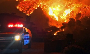The wildfire burns canyons and ridges above Bella Vista Drive near Romero Canyon as the fight to contain a wildfire continued in Montecito, Calif., Tuesday, Dec. 12, 2017.