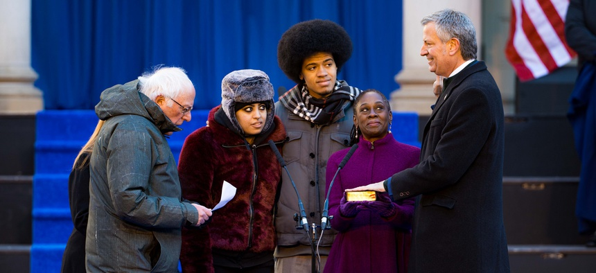 New York City Mayor Bill de Blasio is sworn in by U.S. Sen. Bernie Sanders at the City of New York 2018 inaugural ceremonies on Monday on the steps of City Hall.