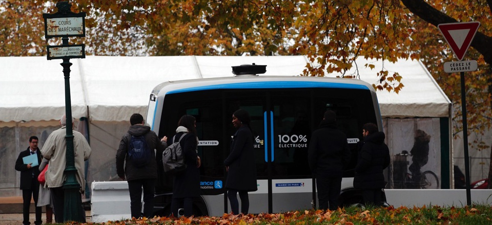 An electric, driverless shuttle produced by EasyMile drives as part of an experiment in Paris, France.
