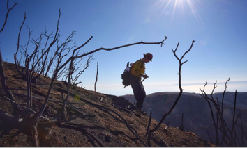 Santa Barbara County Fire Capt. Ryan Thomas hikes down steep terrain below East Camino Cielo while fighting the Thomas Fire on Dec. 19, 2017.