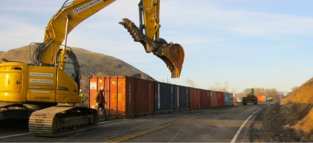 The Washington State Department of Transportation has deployed shipping containers to create a rockfall barrier near the site of a growing fissure on a ridge high above I-82 near Yakima, Wash.
