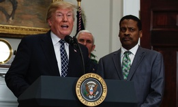 President Trump speaks during an event honoring Martin Luther King Jr. while his nephew, Isaac Newton Farris Jr., listens on Friday at the White House.