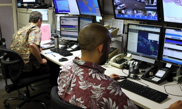 Hawaii Emergency Management Agency officials work at the department's command center in Honolulu on Friday, Dec. 1, 2017.