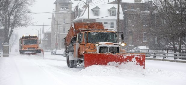 Snow plows attempt to clear the streets Sunday, Jan. 5, 2014, in St. Louis, Missouri