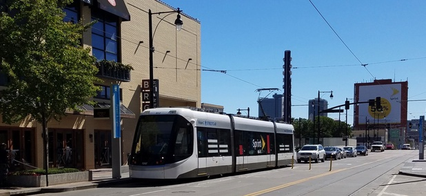 A streetcar vehicle moves along Main Street in downtown Kansas City.