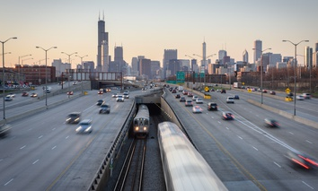 The Chicago Transit Authority's Red Line emerges into the center of the Dan Ryan Expressway south of the Chicago Loop.