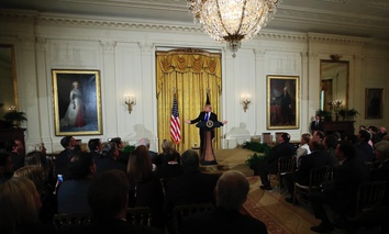 President Donald Trump speaks to a gathering of mayors Wednesday in the East Room of the White House in Washington, D.C.
