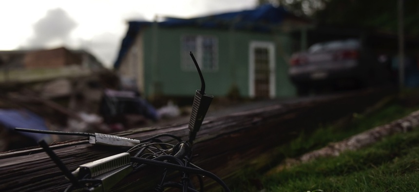 A light pole knocked down by the winds of Hurricane Maria remains on the ground in front of the house of the Oliveras González family in Morovis, Puerto Rico.