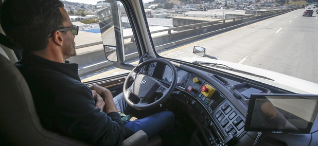 Matt Grigsby, senior program engineer at Otto, takes his hands off the steering wheel of the self-driving, big-rig truck during a demonstration on the highway, Thursday, Aug. 18, 2016, in San Francisco.