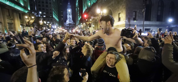 Eagles fans celebrate along Broad Street in Philadelphia on Sunday night.