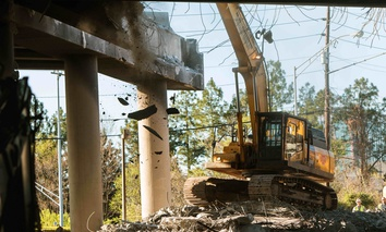 Construction machinery knocks down a section of roadway in Atlanta, during April 2017.