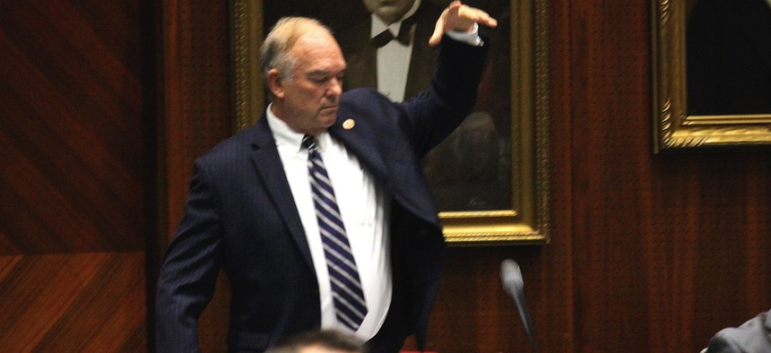 Arizona Republican state Rep. Don Shooter drops his mic after voting no on a resolution expelling him from the Arizona House on Feb. 1 for a pattern of sexual harassment.