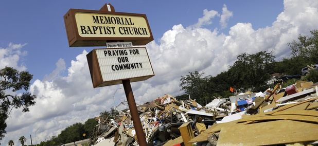 Debris sits outside the Memorial Baptist Church in Port Arthur, Texas, Monday, Sept. 25, 2017. The church was damaged by Hurricane Harvey floodwaters.