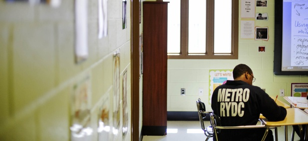 A juvenile resident sits in a classroom at the Department of Juvenile Justice's Metro Regional Youth Detention Center, Wednesday, Aug. 20, 2014, in Atlanta.