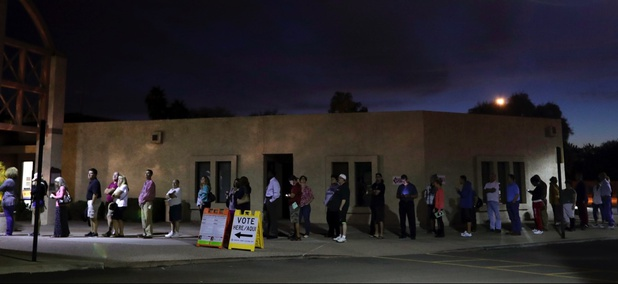 Voters wait for the polls to open at dawn in Phoenix on Election Day 2016.