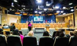 A public meeting in the chambers of the Austin City Council.