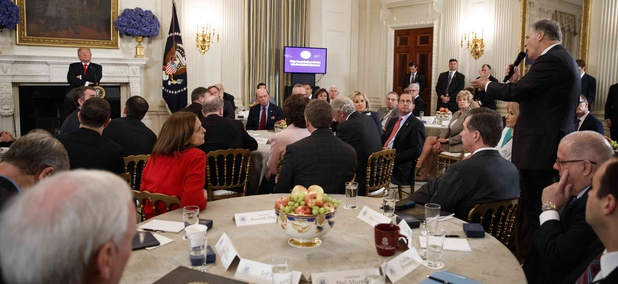 Gov. Jay Inslee, D-Wash., right, speaks about school safety during an event with President Donald Trump and members of the National Governors Association in the State Dining Room of the White House, Monday, Feb. 26, 2018, in Washington.